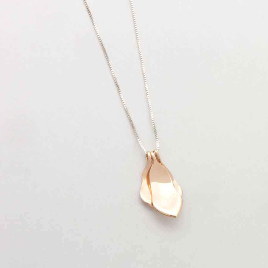 Magnolia flower necklace in 18K rose gold. Handcrafted by Maki Okamoto in her studio in Stockholm.