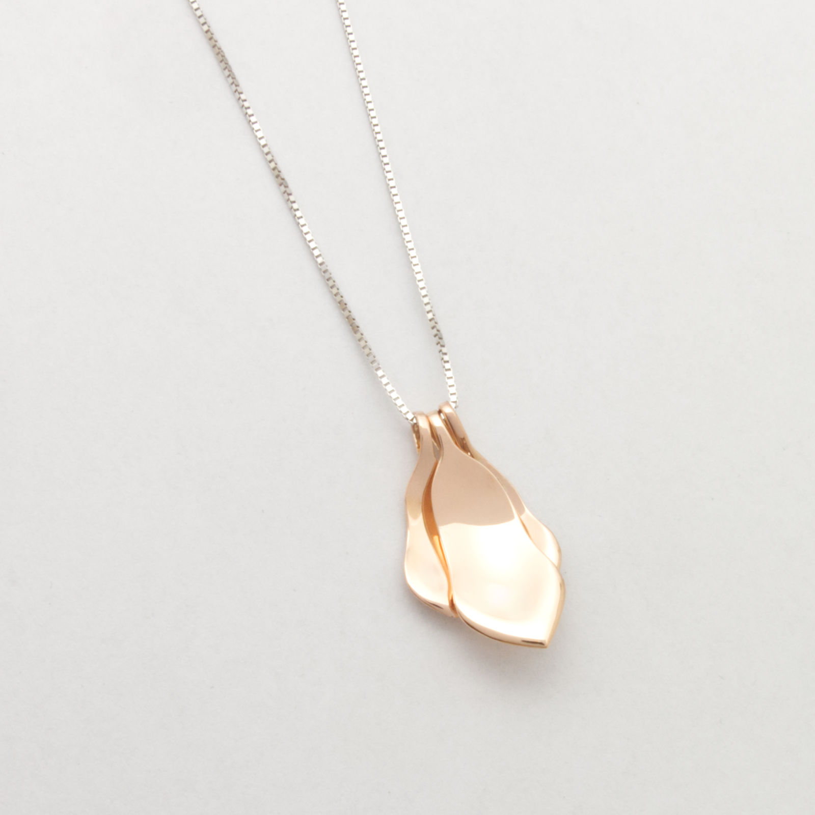 Handcrafted sustainable jewellery with memory of a magnolia tree..